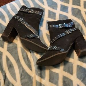 Black boots with silver embellishments and buckles